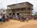 The motorbikes passing the new three-storyclub.