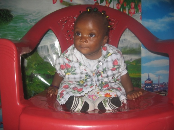 Cute Baby in a Red Chair